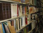color photograph of books on metal library shelving
